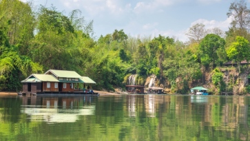 Tourism on the floating house rafting at the river Kwai, Kanchanaburi, Thailand.